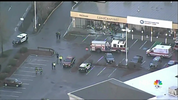 [NECN] One Dead After Car Crashes into Building in Medford