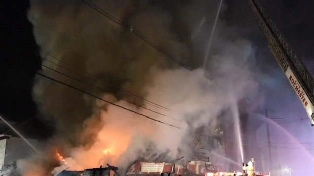 [NECN] Massive Fire in NH; 2 Buildings Collapse