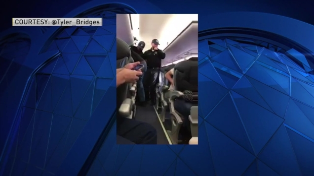[NECN] Cell Phone Footage Shows Man Dragged Off United Airlines Flight