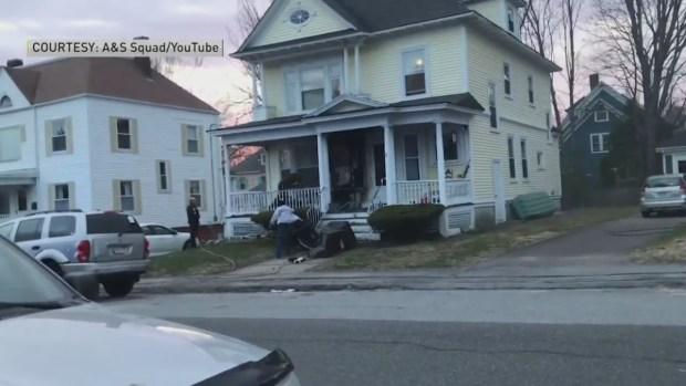 [NECN]RAW VIDEO: UPS Driver Knocks Down Porch Fire