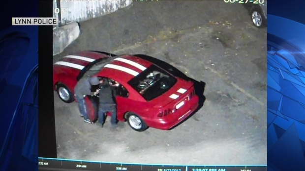 [NECN]VIDEO: Suspects Shoot Robbery Victim Sitting in Car