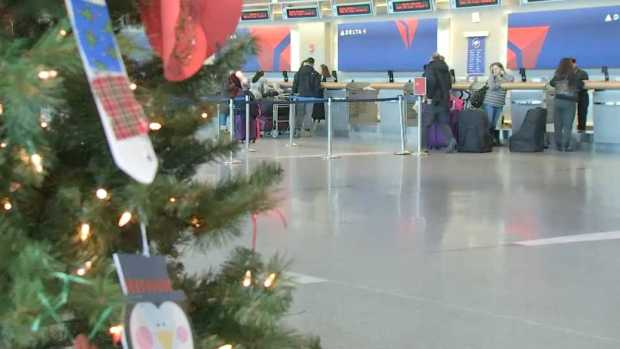 [NECN] Travelers Escaping Boston's Cold Weather