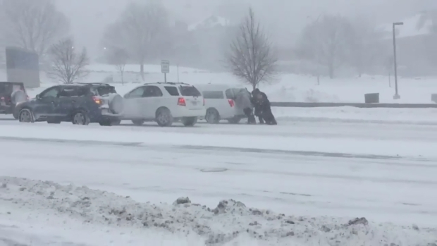 Bystanders Help Hearse Stuck in Snow