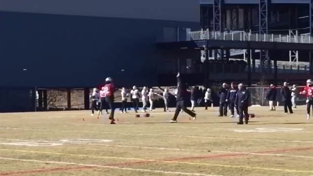 [NECN] Tom Brady Wearing Gloves at Practice