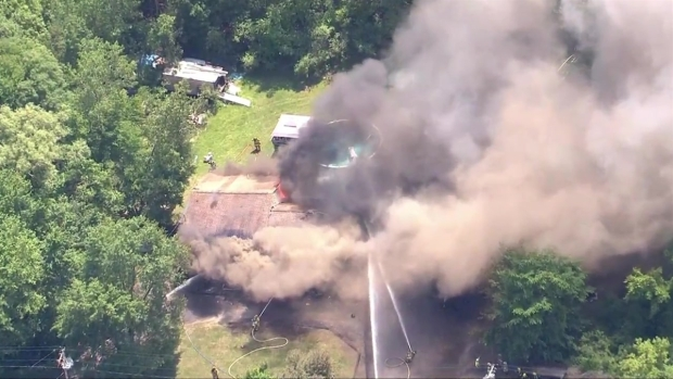 [NECN]RAW VIDEO: Smoky 4-Alarm Fire in Grafton, Mass.