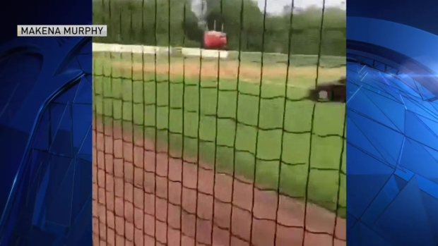 [NECN] Video Shows Woman Erratically Driving on Baseball Field Before Fatal Crash