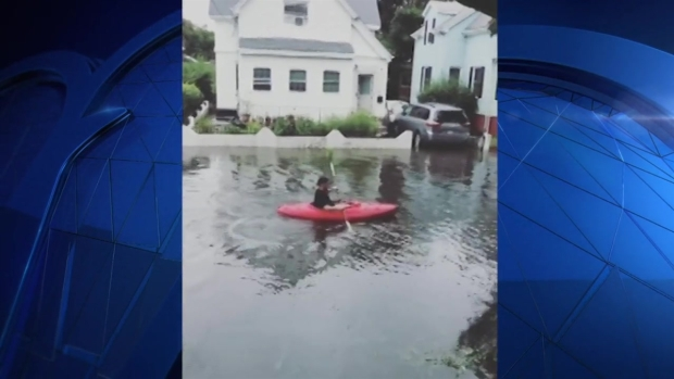 Man Kayaks Down Flooded Street in Lynn, Mass.