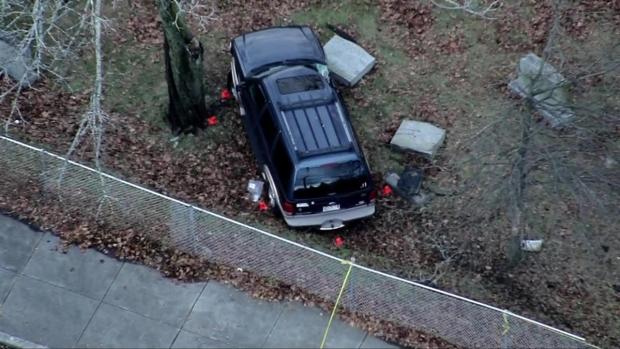 [NECN] Vehicle Crashes Into Mattapan Cemetery