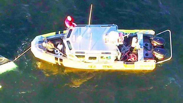 [NECN] FD: 2 Rescued From Capsized Boat in Mashpee