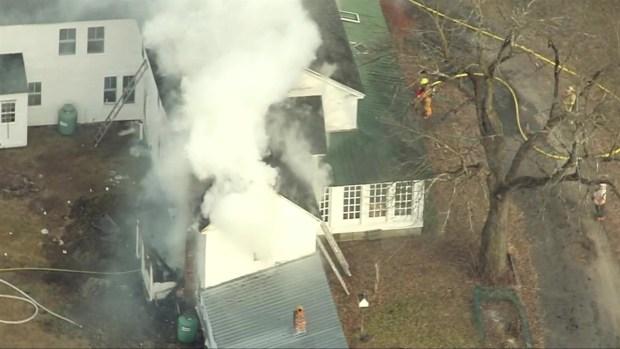 [NECN] Aerials: Crews Battle Fire at Bolton Home