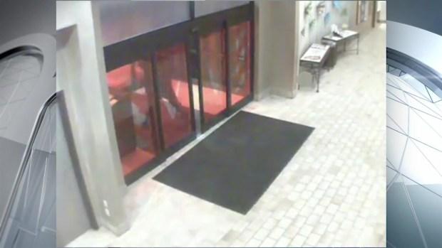[NECN] Surveillance Footage Shows Suspect Firing Shot Into Hotel