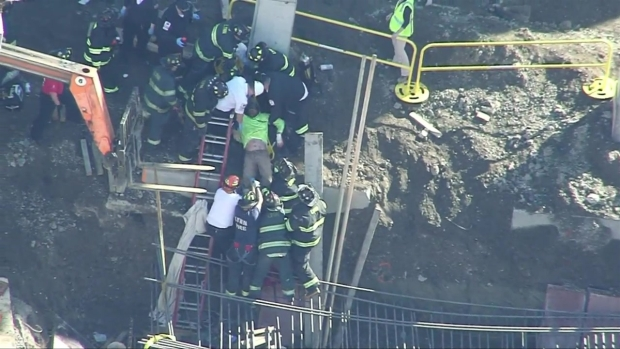 [NECN]WATCH: Dramatic Rescue of Trapped Construction Worker