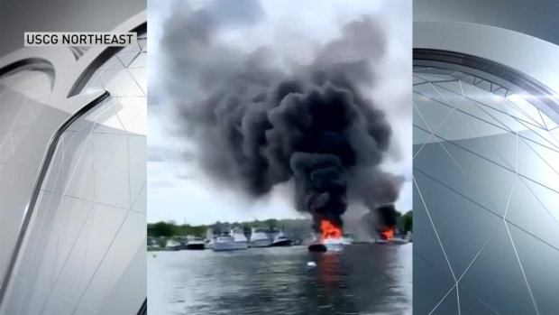 [NECN] 13 Rescued From Burning Boat in Scituate