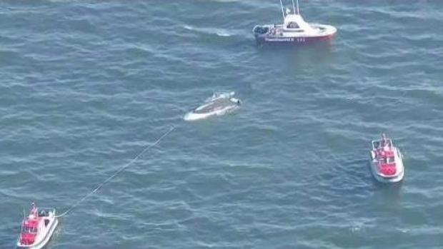 [NECN] Child Hospitalized After Being Rescued From Capsized Boat