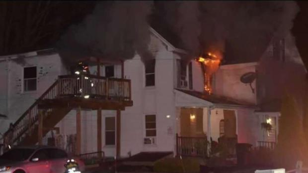 [NECN] Fire Under Investigation After Police Rescue Man