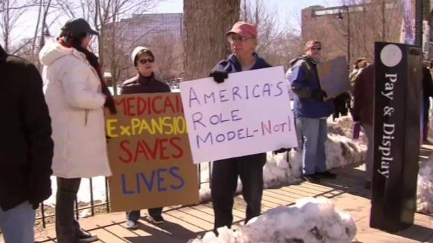 [NECN] Group Protests Trump During Visit to NH