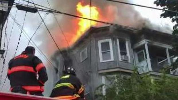 [NECN] Heavy Smoke in Woburn as Fire Rips Through Home