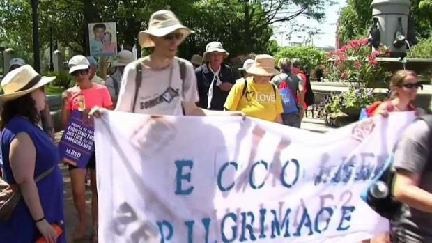 [NECN] Immigration March to ICE Detention Center in NH