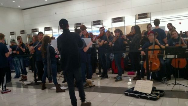 Stranded School Orchestra Plays at Airport While They Wait