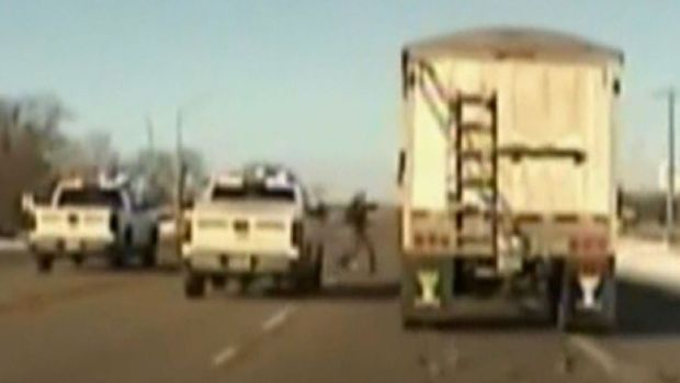 Deputy Jumps Onto Moving Semi Truck