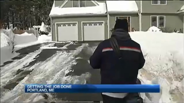 Letter Carriers Fight Snow to Deliver Mail