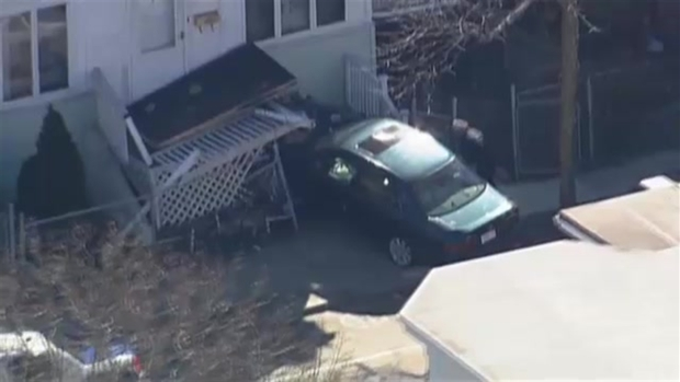 Car Crashes into Boston Home