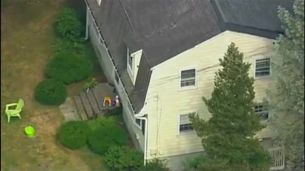 [NECN]AERIAL FOOTAGE: State, Local Police at Framingham, Mass. Home