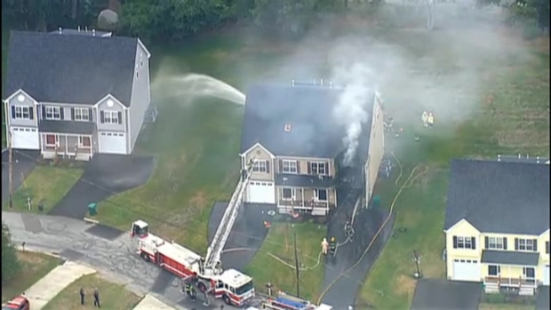 [NECN] AERIAL FOOTAGE: Part of 2-Family Home Catches Fire