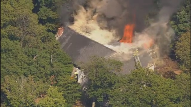 [NECN]AERIAL FOOTAGE: Crews Battle Cohasset House Fire