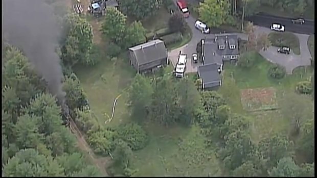 [NECN] AERIAL FOOTAGE: Downed Wires Set Truck on Fire in Topsfield, Massachusetts
