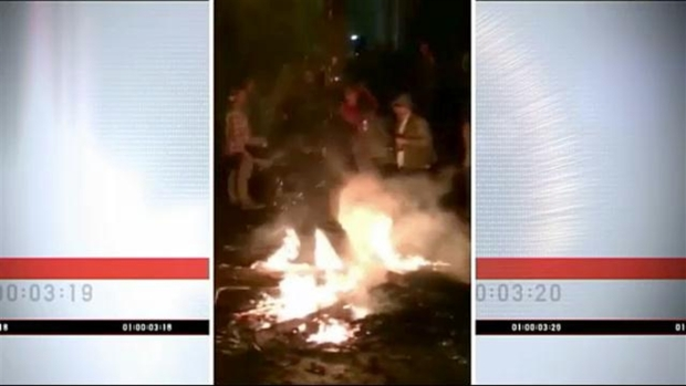 [NECN] WATCH: Person Walks Through Fire During Keene Riot