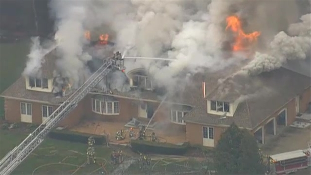 [NECN]AERIAL FOOTAGE: Crews Battle Smoky House Fire