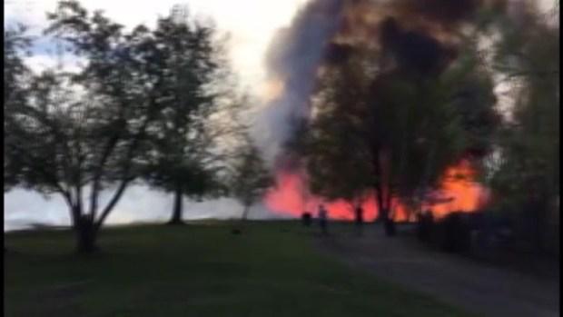 [NECN] Large Brush Fire Burning in Boston