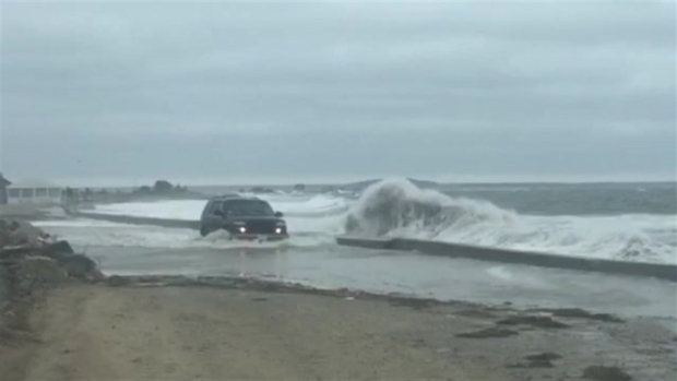 Truck Treks Through High Tide Waves