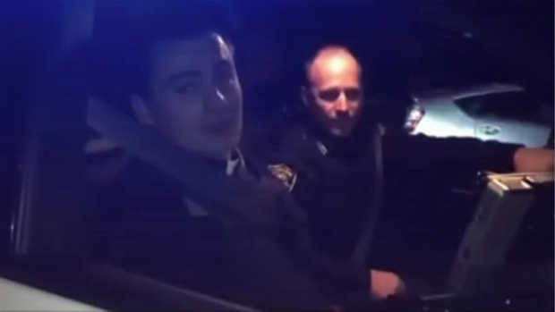 WATCH: Singing Priest Rides Along With Police