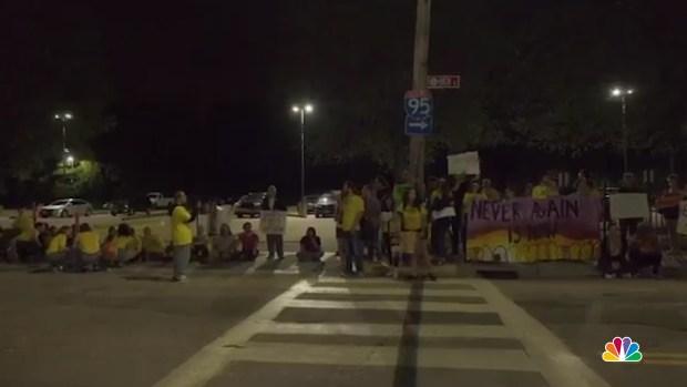 PHOTOS: RI Protesters Face Down Truck, Pepper Spray