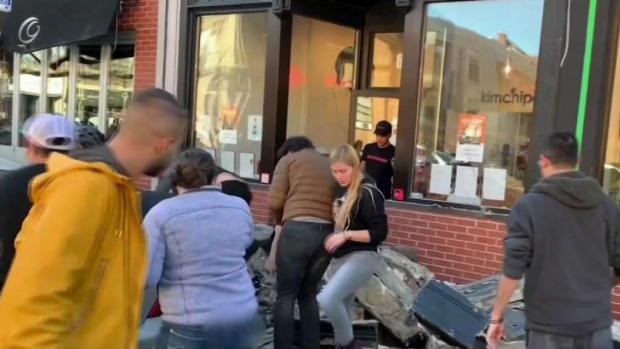 [NECN] Rescue From Rubble Caught on Camera After Wall Collapse
