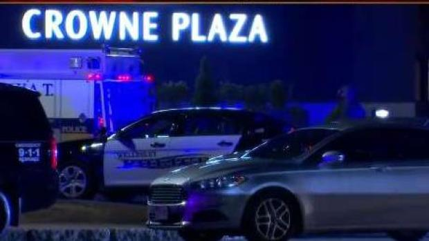 [NECN] Shot Fired at Hotel, Search Underway for Suspects