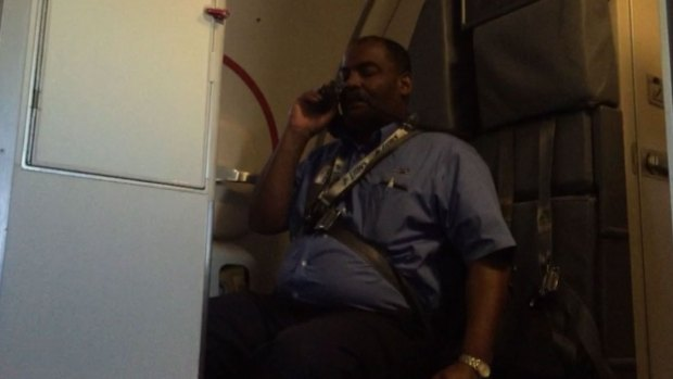 Caught on Cam: Flight Attendant Appears to Become Incapacitated