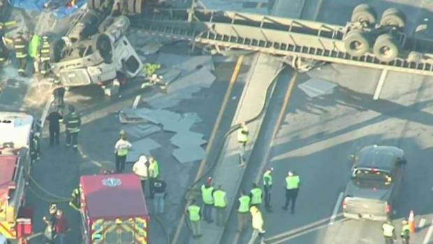 [NECN] Tractor-Trailer Rolls Over at Mass. Pike, I-290 Exchange