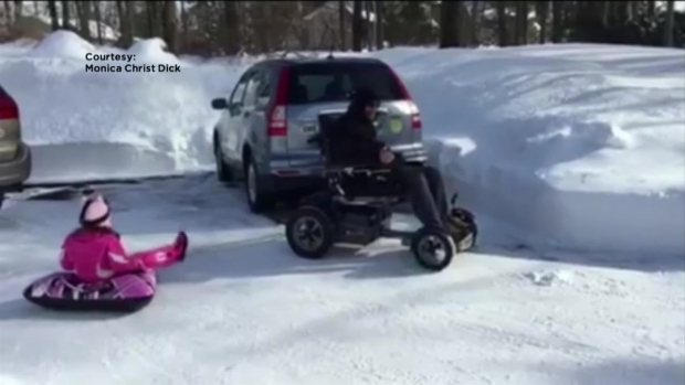 Disabled Father Takes Daughter Sledding