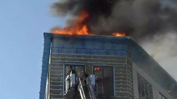 [NECN] Building Under Construction Goes Up in Flames