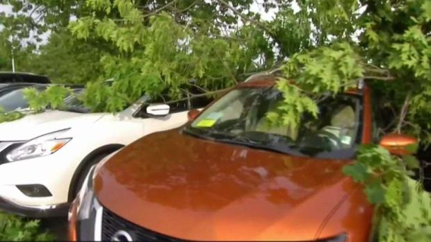 [NECN] Car Dealership Suffers Severe Damage From Storm