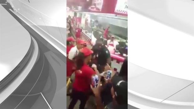 RAW: Fight at Miami Beach Five Guys Restaurant