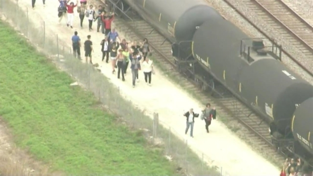 RAW: Aerial Footage of People Lined Up During Active Shooter Situation