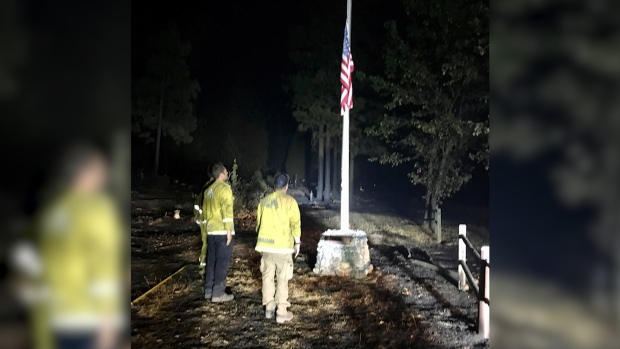 [NATL] Firefighters Find Undamaged US Flag, Lower it to Half Staff