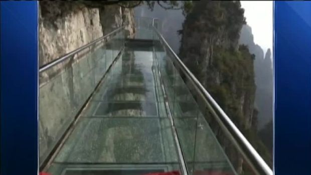 Glass Walkway Over Canyon Cracks With Tourists On It