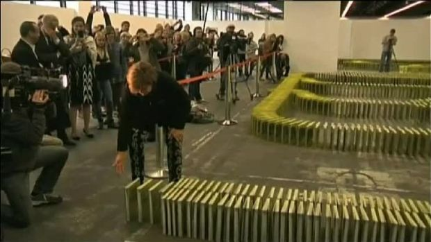 Books Toppled Like Dominoes Set World Record