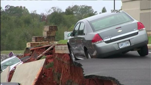 Massive Sinkhole Swallows Up Vehicles