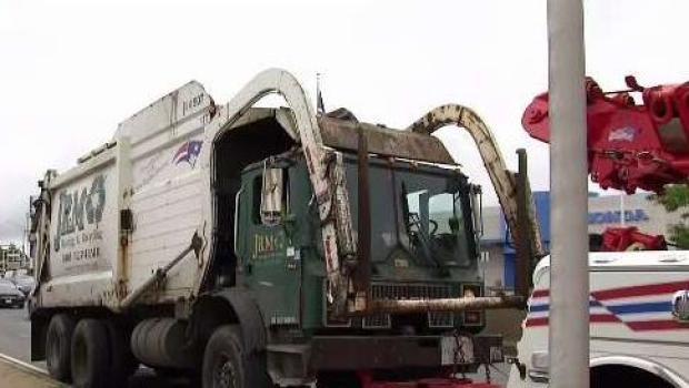 [NECN] Pedestrian Injured After Being Hit by Trash Truck
